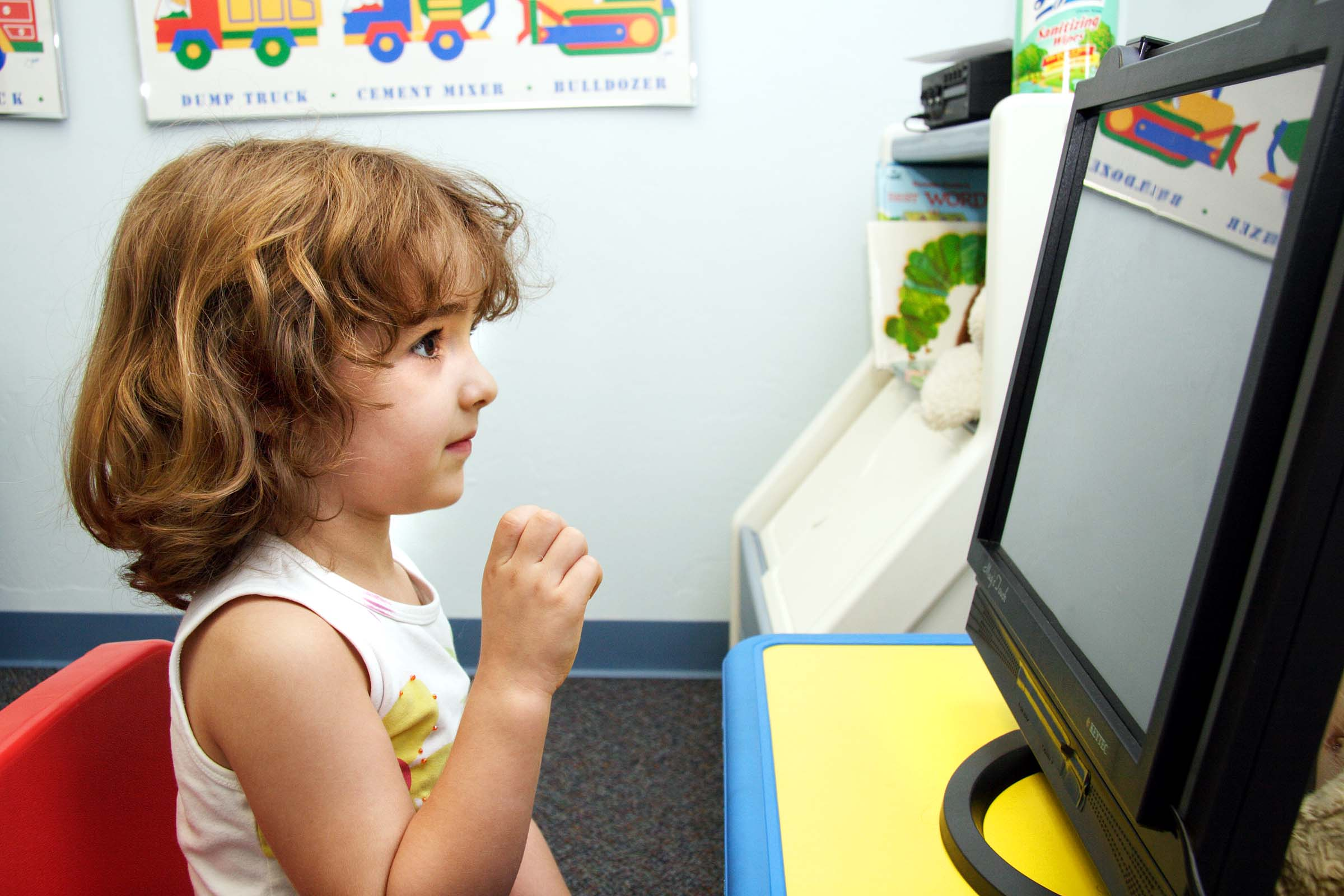 girl looking at computer screen