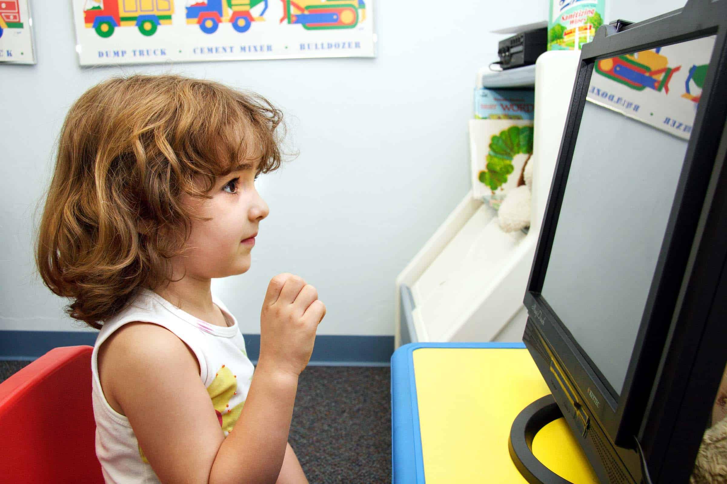 girl looking at computer screen